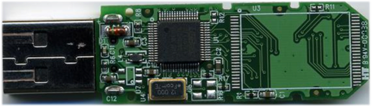 Figure 3 Rear side of USB key circuit showing controller chip (square black device) and oscillator (gold-edged device)